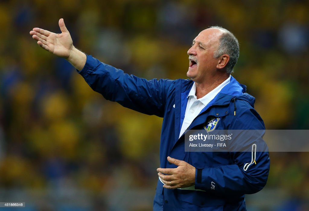 Head coach Luiz Felipe Scolari of Brazil gestures after conceding five goals in the first half during the 2014 FIFA World Cup Brazil Semi Final match between Brazil and Germany at Estadio Mineirao on July 8, 2014 in Belo Horizonte, Brazil.