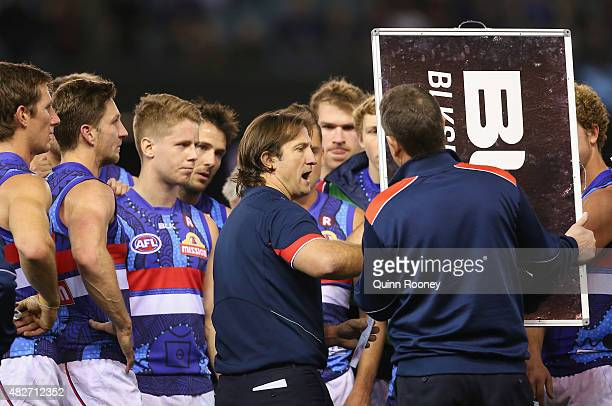 head coach Luke Beveridge of the Bulldogs talks to his players during the round 18 AFL match between the Essendon Bombers and the Western Bulldogs at...
