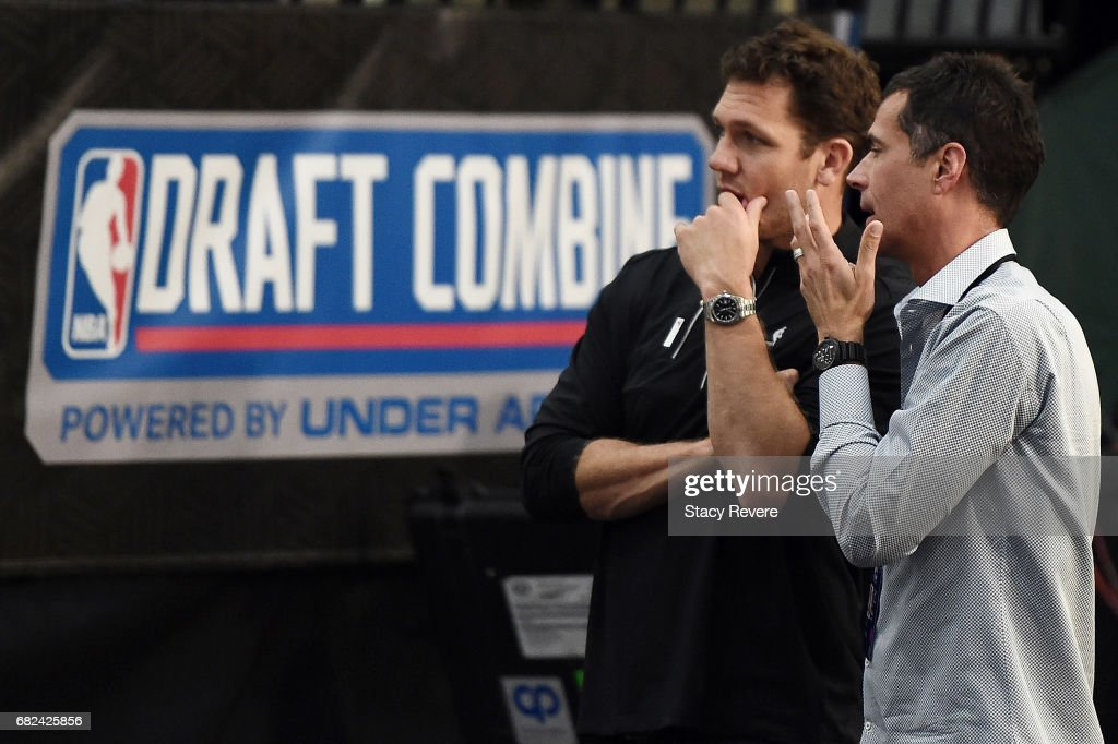 Head coach Luke Walton of the Los Angeles Lakers speaks with General Manager Rob Pelinka during Day Two of the NBA Draft Combine at Quest MultiSport Complex on May 12, 2017 in Chicago, Illinois.