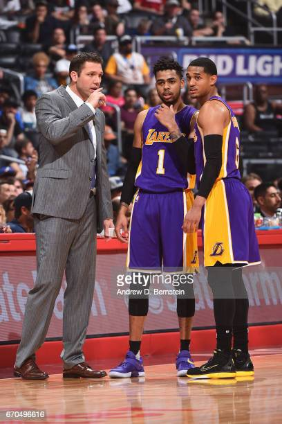 Head Coach Luke Walton talks with D'Angelo Russell and Jordan Clarkson of the Los Angeles Lakers during the game against the LA Clippers on April 1...