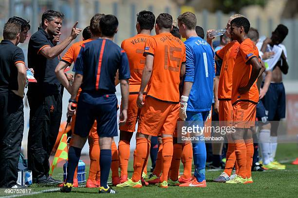 Head coach Maarten Stekelenburg of Netherlands gives instructions during the UEFA Under17 European Championship 2014 group A match between England...