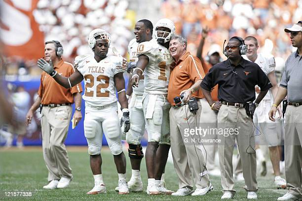 Head coach Mack Brown of Texas hugs Vince Young during the the Big 12 Championship against the Colorado Buffaloes at Reliant Stadium in Houston Texas...