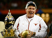 Head coach Mack Brown of the Texas Longhorns celebrates after defeating the Ohio State Buckeyes in the Tostitos Fiesta Bowl Game on January 5 2009 at...