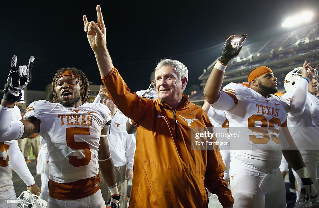 Head coach Mack Brown of the Texas Longhorns celebrates with Desmond Jackson #99 of the Texas Longhorns and <a gi-track='captionPersonalityLinkClicked' href=/galleries/search?phrase=Josh+Turner&family=editorial&specificpeople=571975 ng-click='$event.stopPropagation()'>Josh Turner</a> #5 of the Texas Longhorns after the Longhorns beat the TCU Horned Frogs 30-7 at Amon G. Carter Stadium on October 26, 2013 in Fort Worth, Texas.