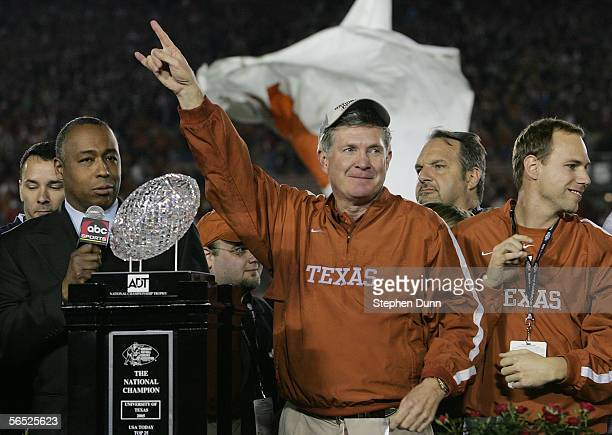 Head coach Mack Brown of the Texas Longhorns celebrates with the National Championship trophy after defeating the USC Trojans 4138 to win the BCS...