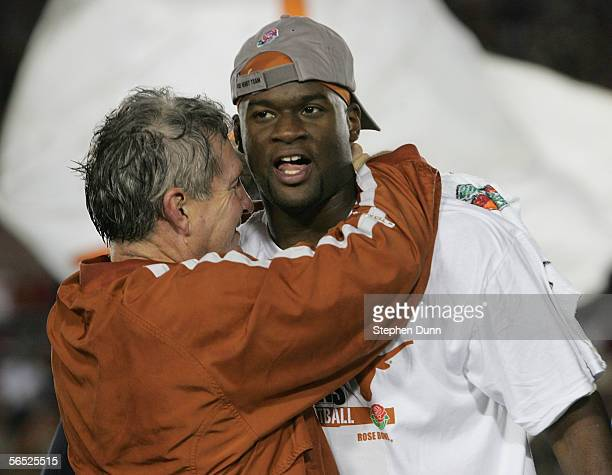 Head coach Mack Brown of the Texas Longhorns celebrates with Vince Young after defeating the USC Trojans 4138 to win the BCS National Championship...
