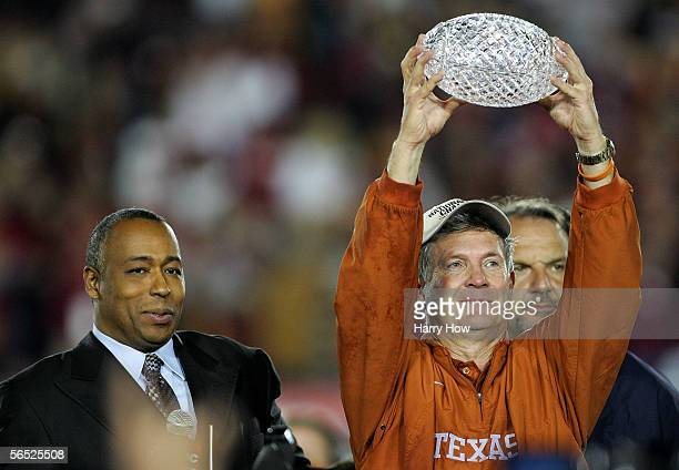 Head coach Mack Brown of the Texas Longhorns holds up the championship trophy after defeating the USC Trojans in the final moments of the BCS...