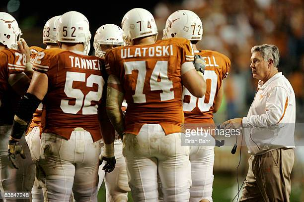 Head coach Mack Brown of the Texas Longhorns steps into the huddle during a timeout against the Texas AM Aggies in the fourth quarter at Darrell K...