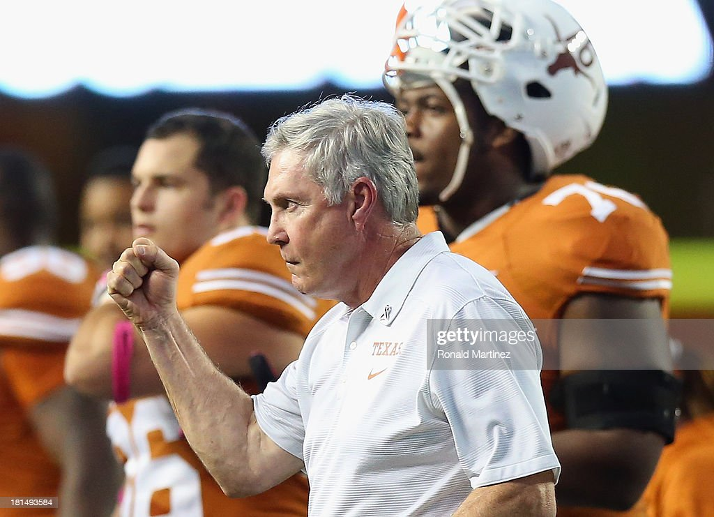 Head coach Mack Brown pumps his fist after a call was overturned during play against the Kansas State Wildcats at Darrell K Royal-Texas Memorial Stadium on September 21, 2013 in Austin, Texas.