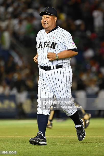 Head Coach Mamoru Koeda of U18 Japan looks on in the top half of the sixth inning during in the sendoff game between U18 Japan and Collegiate Japan...