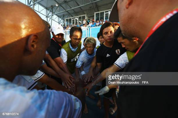Head coach / Manager of Japan Marcelo Mendes speaks to his tream during the FIFA Beach Soccer World Cup Bahamas 2017 group D match between Braziland...