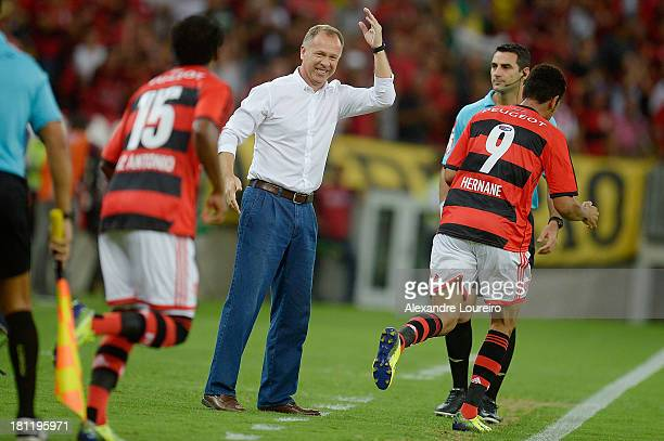 Head Coach Mano menezes of Flamengo celebrates a scored goal during the match between Flamengo and Atletico Paranaense for the Brazilian Series A...