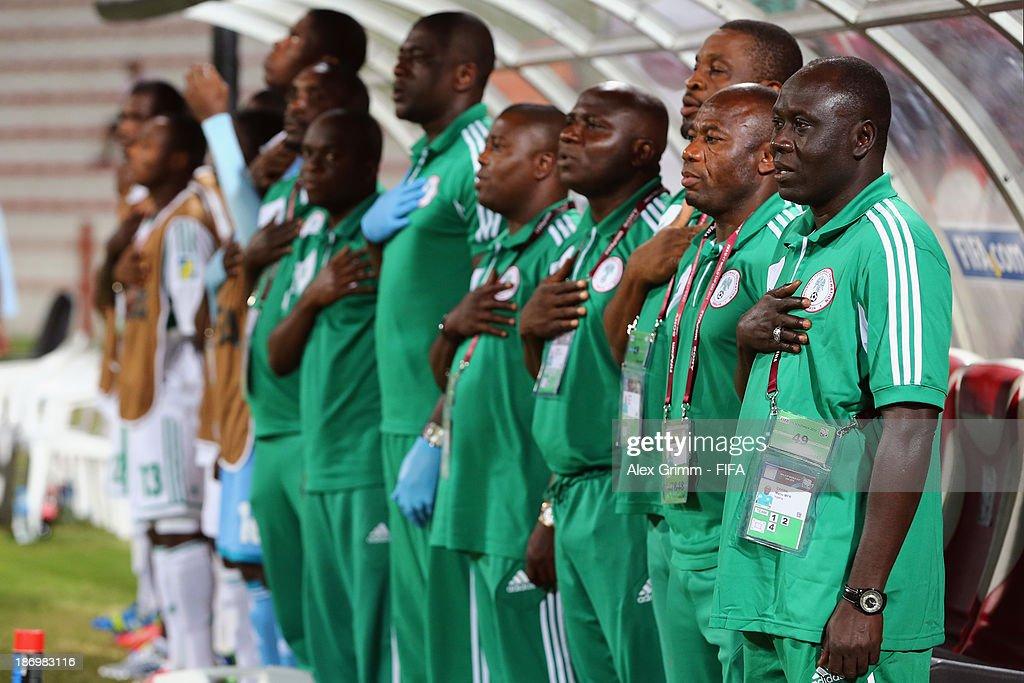 Head coach Manu Garba of Nigeria and team members sing their national anthem prior to the FIFA U-17 World Cup UAE 2013 Semi Final match between Sweden and Nigeria at Al Rashid Stadium on November 5, 2013 in Dubai, United Arab Emirates.