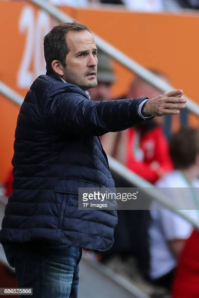Head coach Manuel Baum of Augsburg gestures during the Bundesliga match between FC Augsburg and Borussia Dortmund at the WWKArena on May 13 2017 in...