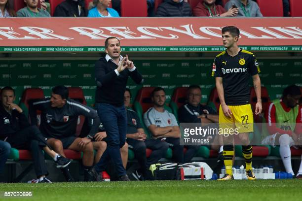 Head coach Manuel Baum of Augsburg gestures during the Bundesliga match between FC Augsburg and Borussia Dortmund at WWKArena on September 30 2017 in...