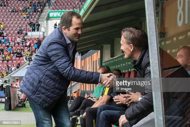 Head coach Manuel Baum of Augsburg shakes hands with CEO HansJoachim Watzke of Dortmund during the Bundesliga match between FC Augsburg and Borussia...