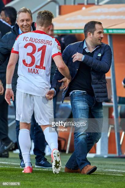 Head coach Manuel Baum of Augsburg shakes hands with Philipp Max of Augsburg during the Bundesliga match between FC Augsburg and Hamburger SV at WWK...