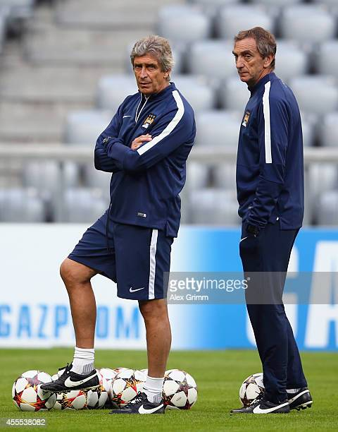 Head coach Manuel Pellegrini and assistant coach Ruben Cousillas attend the Manchester City training session ahead of their UEFA Champions League...