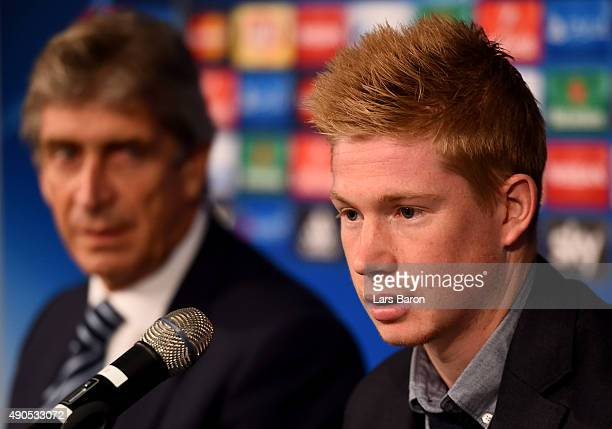 Head coach Manuel Pellegrini is seen next to Kevin de Bruyne during a Manchester City press conference on the eve of the UEFA Champions League groupe...