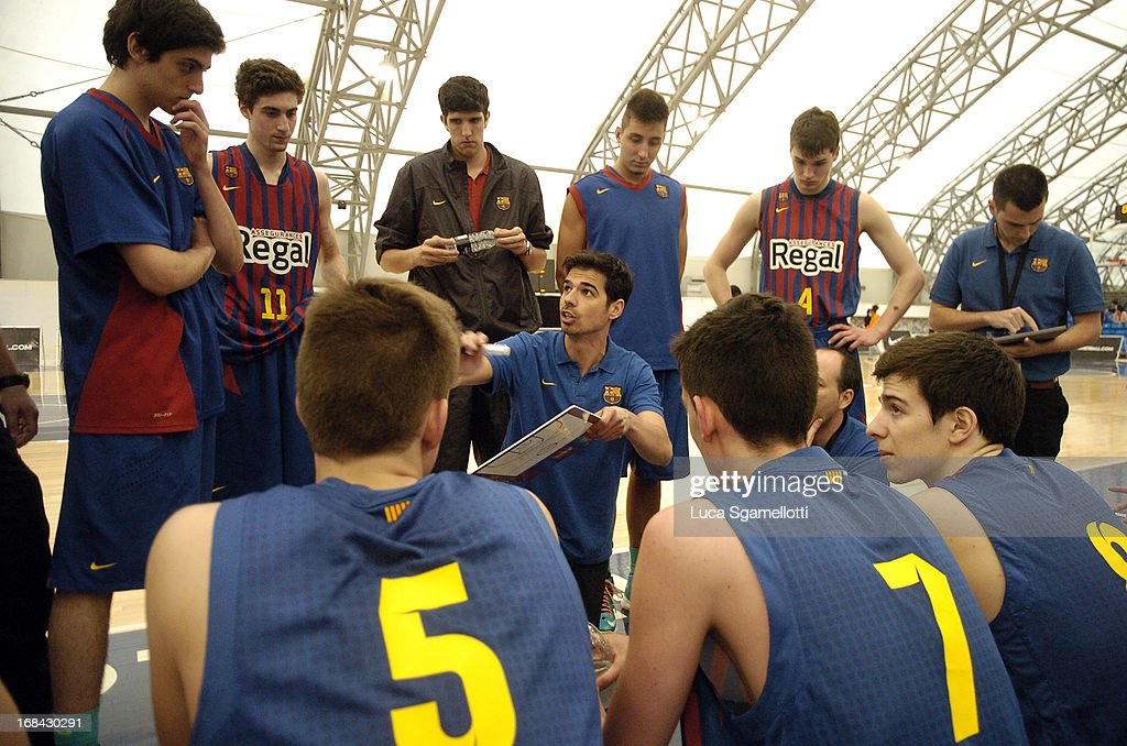 Head coach Marc Calderon of FC Barcelona Regal instructs his players during the Nike International Junior Tournament game between FC Barcelona Regal v Team England at London Soccerdome on May 9, 2013 in London, United Kingdom.