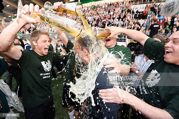 Head coach Marc Fascher gets a beer shower after the Regionalliga West match between Preussen Muenster and Borussia Moenchengladbach II at the...