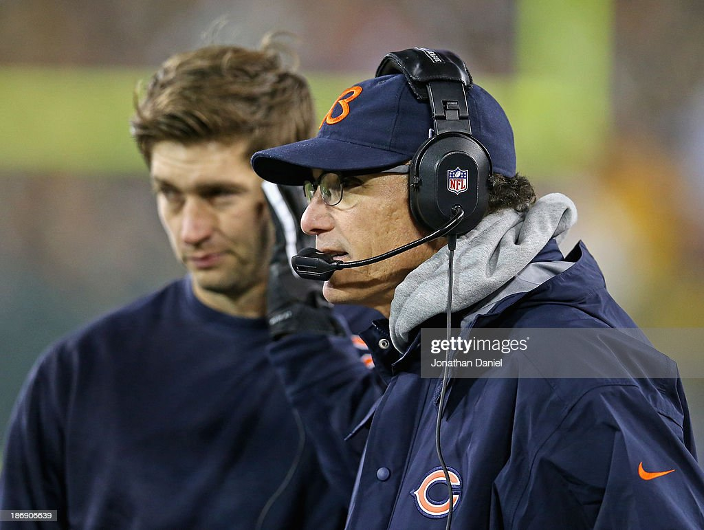 Head coach Marc Trestman of the Chicago Bears calls a play against the Green Bay Packers as Jay Cutler #6 (L) listens in at Lambeau Field on November 4, 2013 in Green Bay, Wisconsin. The Bears defeated the Packers 27-20.