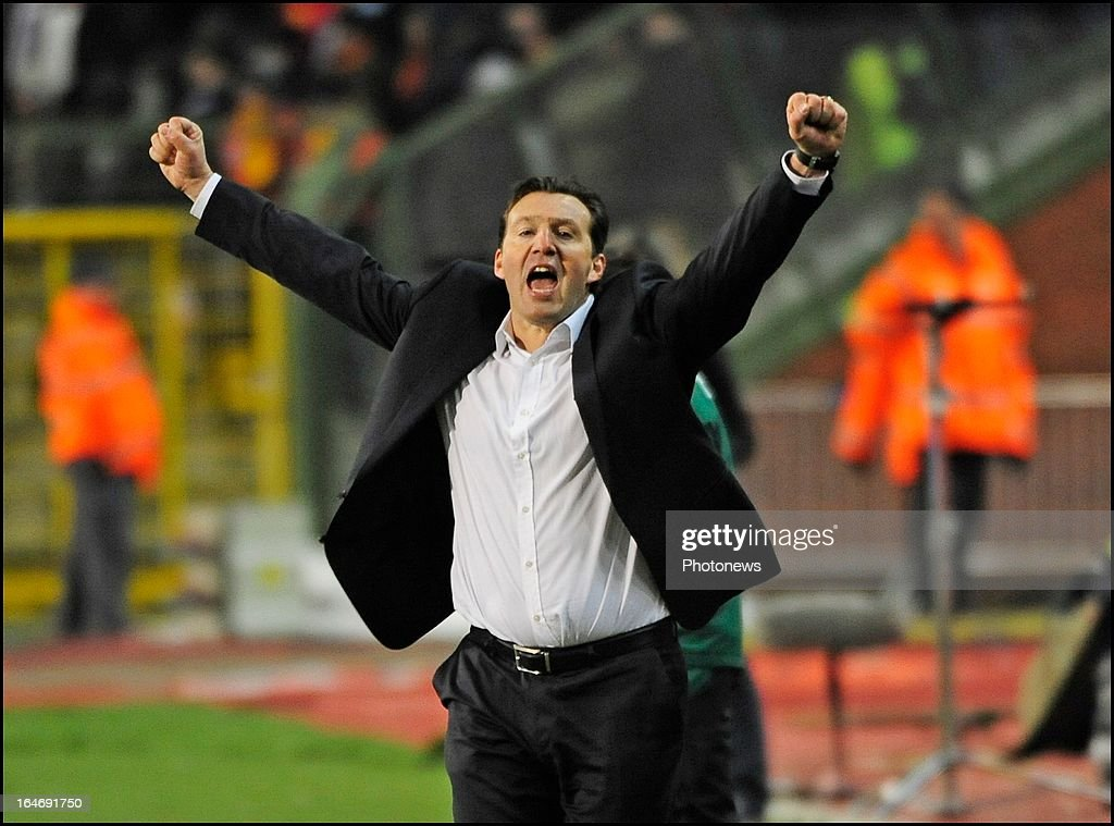 Head coach Marc Wilmots of Belgium celebrates Eden Hazard of Belgium scored the opening goal during the FIFA 2014 World Cup Group A qualifying match between Belgium and Macedonia at the King Baudouin stadium on March 26, 2013 in Brussels, Belgium.