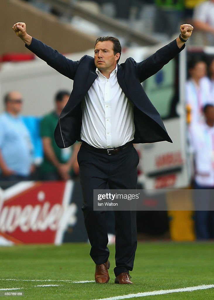 Head coach <a gi-track='captionPersonalityLinkClicked' href=/galleries/search?phrase=Marc+Wilmots&family=editorial&specificpeople=1016207 ng-click='$event.stopPropagation()'>Marc Wilmots</a> of Belgium celebrates his team's 2-1 victory over Algeria during the 2014 FIFA World Cup Brazil Group H match between Belgium and Algeria at Estadio Mineirao on June 17, 2014 in Belo Horizonte, Brazil.