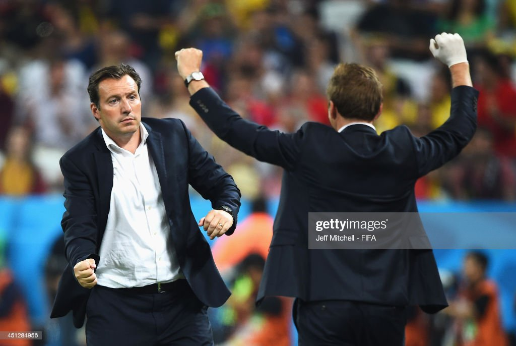 Head coach Marc Wilmots of Belgium celebrates the 10 win with a team staff after the 2014 FIFA World Cup Brazil Group H match between Korea Republic...