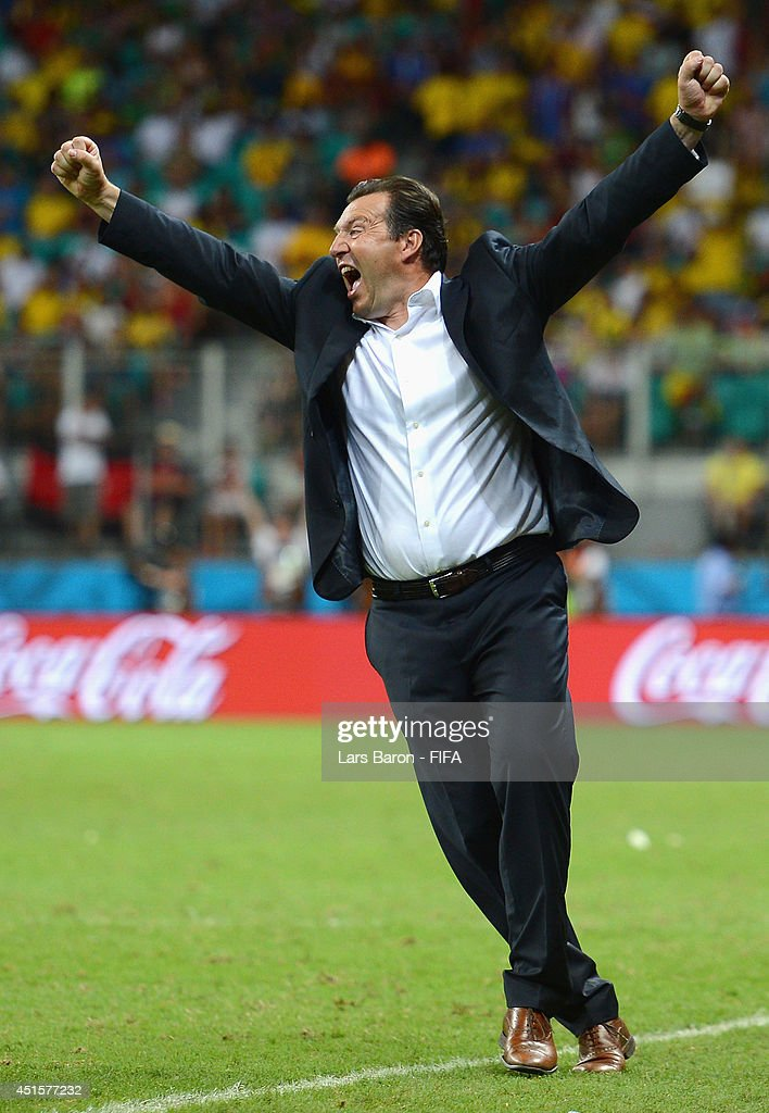 Head coach <a gi-track='captionPersonalityLinkClicked' href=/galleries/search?phrase=Marc+Wilmots&family=editorial&specificpeople=1016207 ng-click='$event.stopPropagation()'>Marc Wilmots</a> of Belgium celebrates victory after the 2014 FIFA World Cup Brazil Round of 16 match between Belgium and USA at Arena Fonte Nova on July 1, 2014 in Salvador, Brazil.