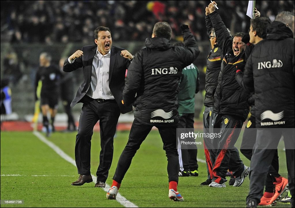 Head coach <a gi-track='captionPersonalityLinkClicked' href=/galleries/search?phrase=Marc+Wilmots&family=editorial&specificpeople=1016207 ng-click='$event.stopPropagation()'>Marc Wilmots</a> of Belgium celebrates with team-mates during the FIFA 2014 World Cup Group A qualifying match between Belgium and Macedonia at the King Baudouin stadium on March 26, 2013 in Brussels, Belgium.