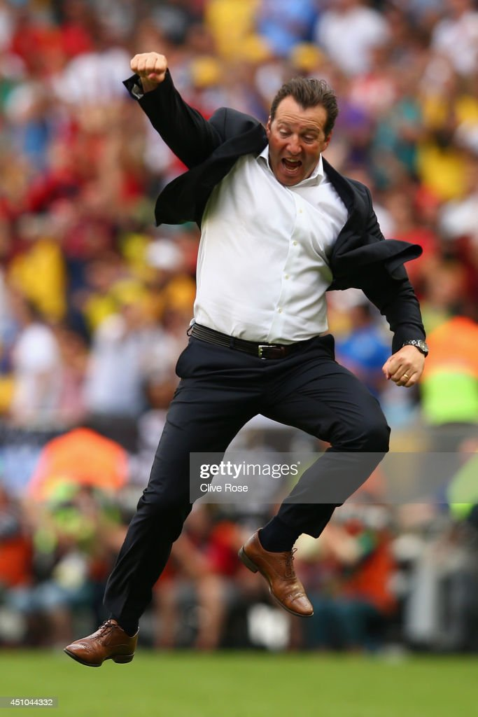 Head coach <a gi-track='captionPersonalityLinkClicked' href=/galleries/search?phrase=Marc+Wilmots&family=editorial&specificpeople=1016207 ng-click='$event.stopPropagation()'>Marc Wilmots</a> of Belgium reacts after defeating Russia 1-0 during the 2014 FIFA World Cup Brazil Group H match between Belgium and Russia at Maracana on June 22, 2014 in Rio de Janeiro, Brazil.