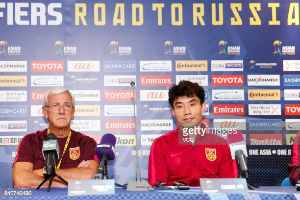 Head coach Marcello Lippi and player Zheng Zhi of China attend a press conference ahead of 2018 FIFA World Cup qualifier game between Qatar and China...