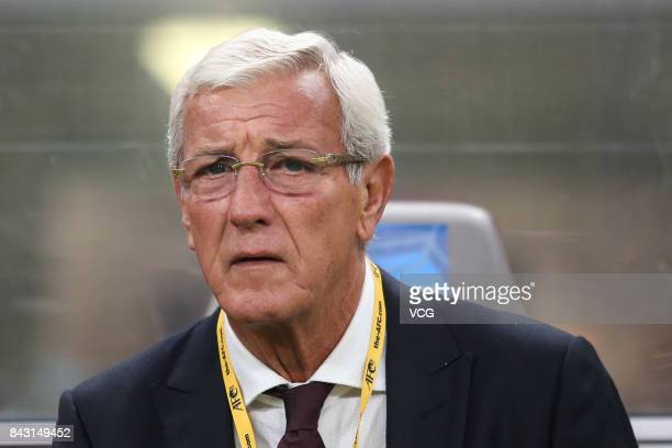 Head coach Marcello Lippi of China reacts during the 2018 FIFA World Cup qualifier game between Qatar and China at Khalifa International Stadium on...