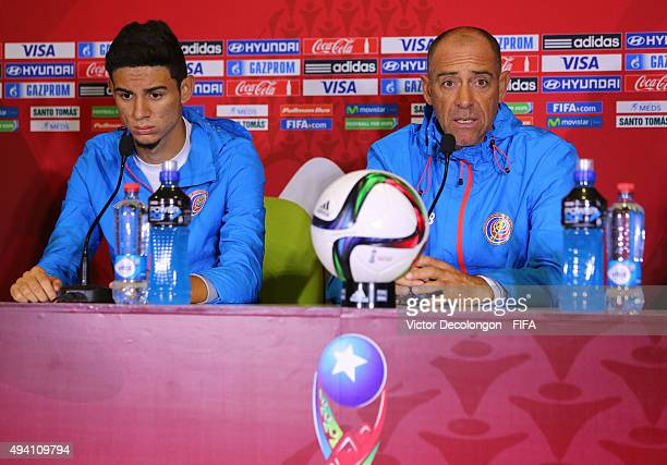 Head Coach Marcelo Herrera of Costa Rica speaks during a press conference as Diego Mesen looks on at Estadio Chinquihue on October 24 2015 in Puerto...