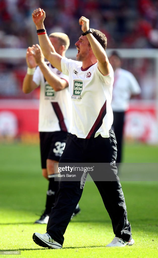 Head coach <a gi-track='captionPersonalityLinkClicked' href=/galleries/search?phrase=Marco+Kurz&family=editorial&specificpeople=2383064 ng-click='$event.stopPropagation()'>Marco Kurz</a> of Kaiserslautern celebrates after winning the Bundesliga match between 1. FC Koeln and 1. FC Kaiserslautern at RheinEnergieStadion on August 21, 2010 in Cologne, Germany.