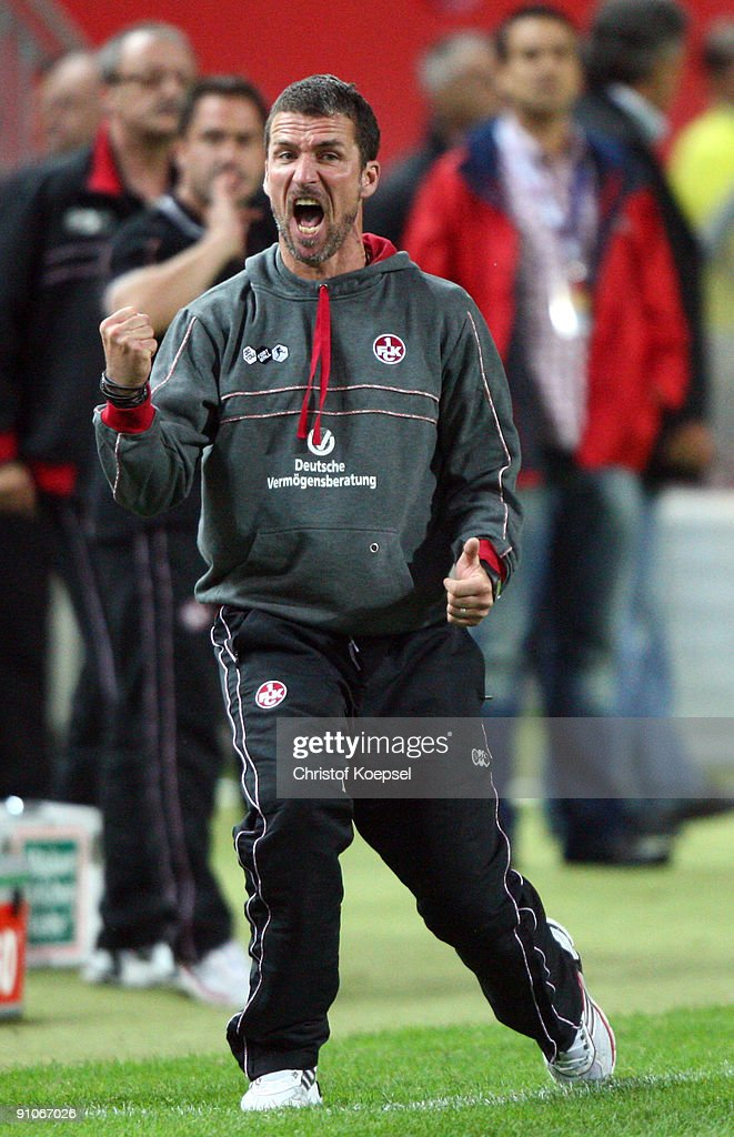 Head coach Marco Kurz of Kaiserslautern celebrates the 21 victory after the DFB Cup second round match between 1 FC Kaiserslautern and Bayer...