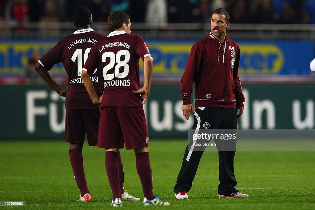 Head coach <a gi-track='captionPersonalityLinkClicked' href=/galleries/search?phrase=Marco+Kurz&family=editorial&specificpeople=2383064 ng-click='$event.stopPropagation()'>Marco Kurz</a> of Kaiserslautern discusses with Kostas Fortounis and <a gi-track='captionPersonalityLinkClicked' href=/galleries/search?phrase=Richard+Sukuta-Pasu&family=editorial&specificpeople=4159199 ng-click='$event.stopPropagation()'>Richard Sukuta-Pasu</a> (R-L) after the Bundesliga match between between 1. FC Kaiserslautern and VfB Stuttgart at Fritz-Walter Stadium on September 30, 2011 in Kaiserslautern, Germany.