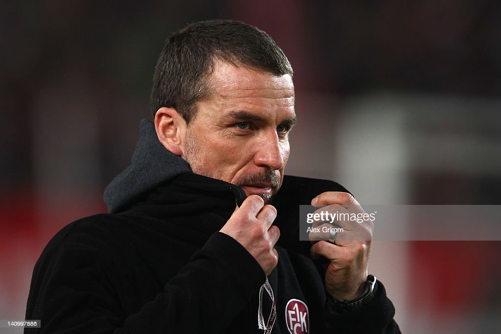 Head coach <a gi-track='captionPersonalityLinkClicked' href=/galleries/search?phrase=Marco+Kurz&family=editorial&specificpeople=2383064 ng-click='$event.stopPropagation()'>Marco Kurz</a> of Kaiserslautern reacts prior to the Bundesliga match between VfB Stuttgart and 1. FC Kaiserslautern at Mercedes-Benz Arena on March 9, 2012 in Stuttgart, Germany.