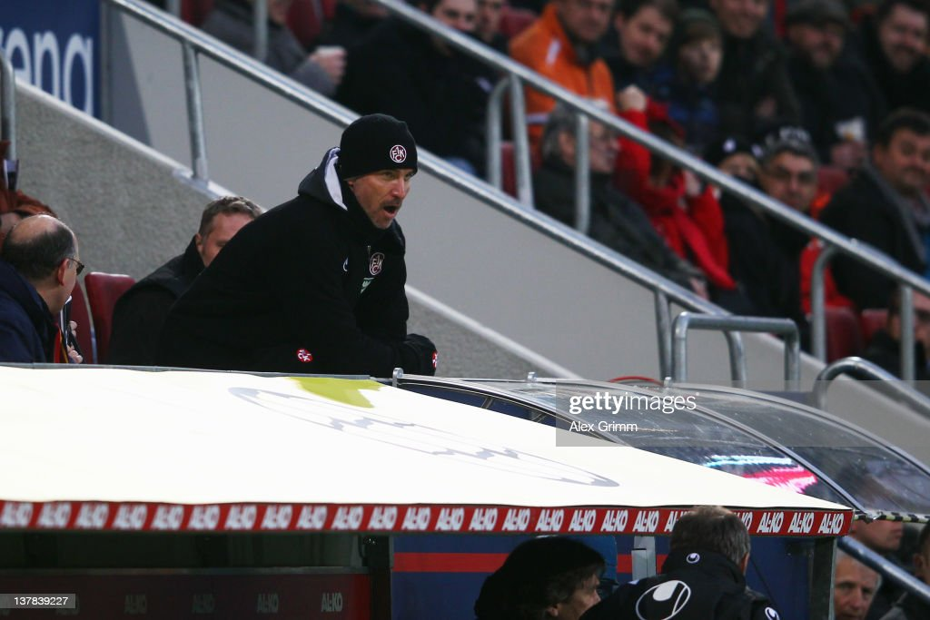 Head coach Marco Kurz of Kaiserslautern watches the Bundesliga match between FC Augsburg and 1 FC Kaiserslautern after being sent to the tribune at...