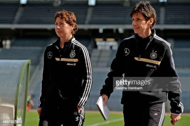 Head coach Maren Meinert of Germany and assistant coach Bettina Wiegmann look on during the UEFA Under19 Women's Elite Round match between Belgium...