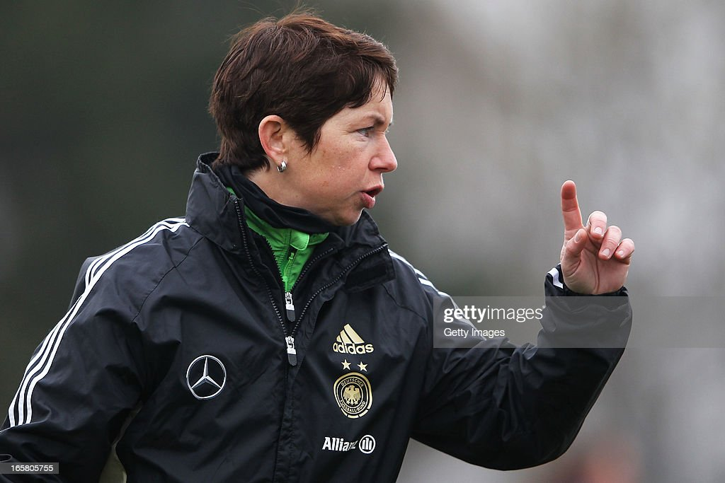 Head coach <a gi-track='captionPersonalityLinkClicked' href=/galleries/search?phrase=Maren+Meinert&family=editorial&specificpeople=639230 ng-click='$event.stopPropagation()'>Maren Meinert</a> of Germany gestures prior to the Women's UEFA U19 Euro Qualification match between U19 Germany and U19 Greece at Sportzentrum Sued on April 6, 2013 in Kirchheim, Germany.