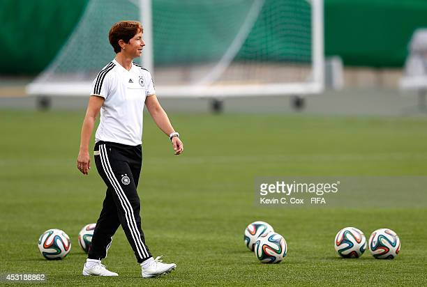 Head coach Maren Meinert of Germany looks on during training on August 4 2014 at Commonwealth Stadium in Edmonton Alberta Canada