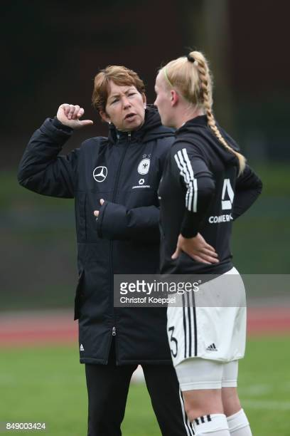 Head coach Maren Meinert speaks to Meret Wittje of Germany prior to the UEFA Under19 Women's Euro Qualifier match between Germany and Iceland at...