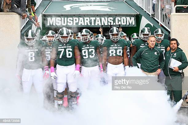 Head coach Mark Dantonio of the Michigan State Spartans leads his team onto the field prior to the game against the Indiana Hoosiers at Spartan...