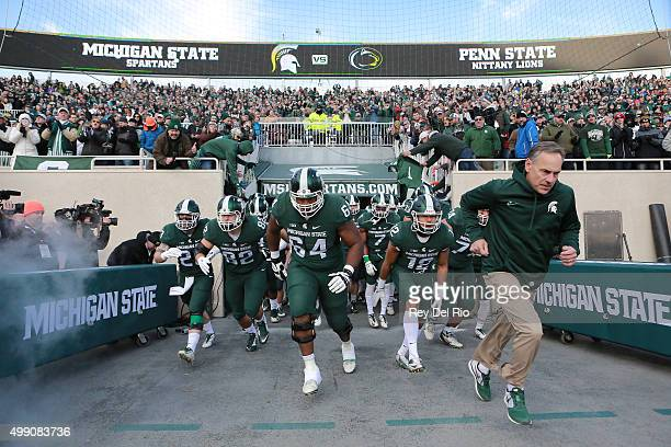 Head coach Mark Dantonio of the Michigan State Spartans leads his team onto the field prior to a game against the Penn State Nittany Lions at Spartan...