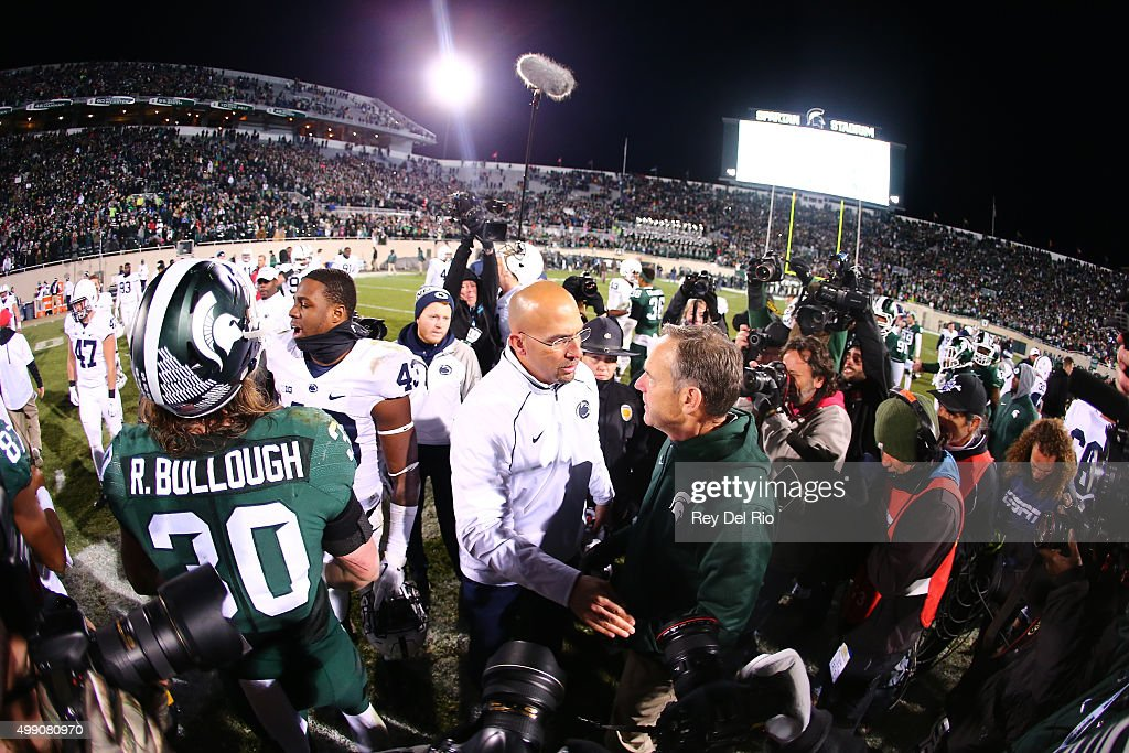 Head coach Mark Dantonio of the Michigan State Spartans shake hands with head coach James Franklin of the Penn State Nittany Lions after the game at Spartan Stadium on November 28, 2015 in East Lansing, Michigan. Michigan State defeated Penn State 55-16 to clinch a berth in the Big Ten championship game.