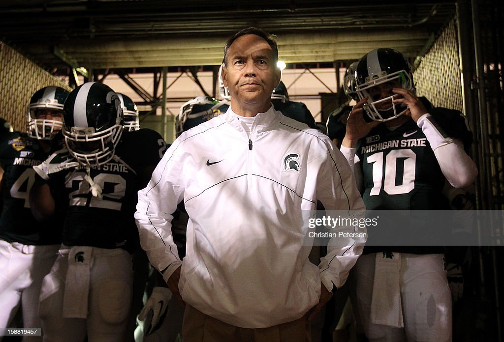 Head coach Mark Dantonio of the Michigan State Spartans stands with his team before taking the field for the Buffalo Wild Wings Bowl against the TCU Horned Frogs at Sun Devil Stadium on December 29, 2012 in Tempe, Arizona. The Spartans defeated the Horned Frogs 17-16.