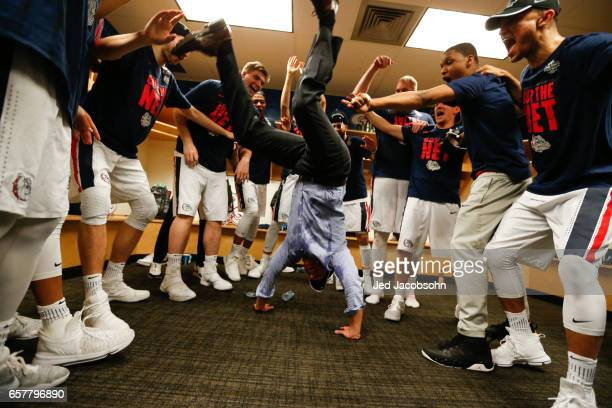 Head Coach Mark Few center of the Gonzaga Bulldogs celebrates a 8359 win in the locker room over the Xavier University Musketeers during the 2017...