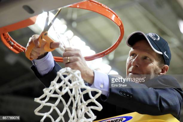 Head coach Mark Few of the Gonzaga Bulldogs cuts down the net after their 83 to 59 win over the Xavier Musketeers during the 2017 NCAA Men's...